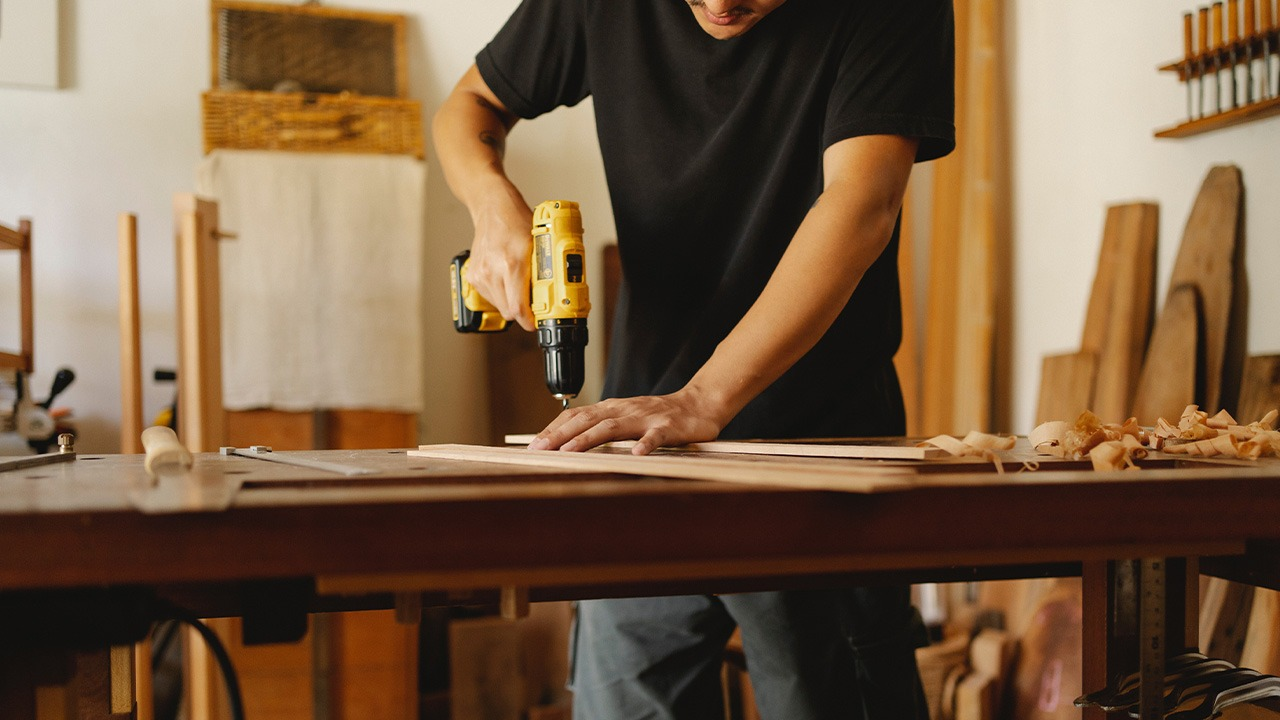 This image shows a man installing kitchen counters.