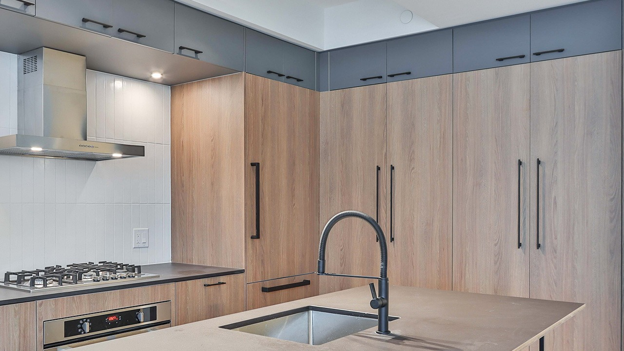 This is an image of a kitchen with a beautiful cabinet and wall paint.